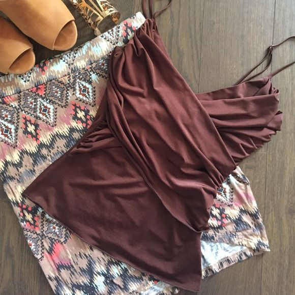 Brown Cami • body suit fit Feels like a bodysuit top. Tight and fit. Great drapery on front makes it look thicker. Looks great when tucked in. Beautiful sheen on fabric . Rampage Tops Camisoles