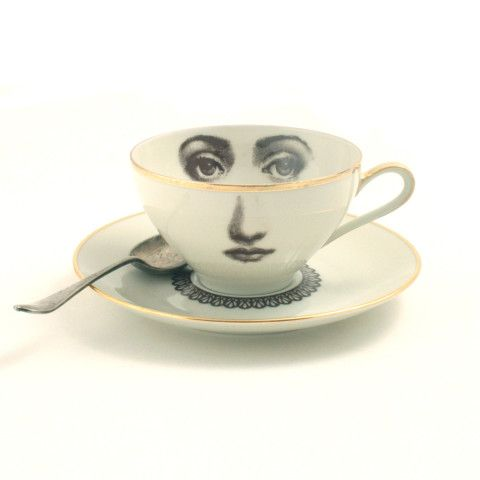 vintage german white semi-opaque sugar-white Eschenbach coffee/ tea cup with a matching saucer both decorated with a golden trim. Pieces have been fired in a professional ceramic kiln after the image application. The color of the drawings are reddish brown to dark brown even if they do sometimes appear to be black on the pictures. On the cup a woman's face inspired of Fornasetti's work and on the saucer a fine lace collar. Size: cup's ...