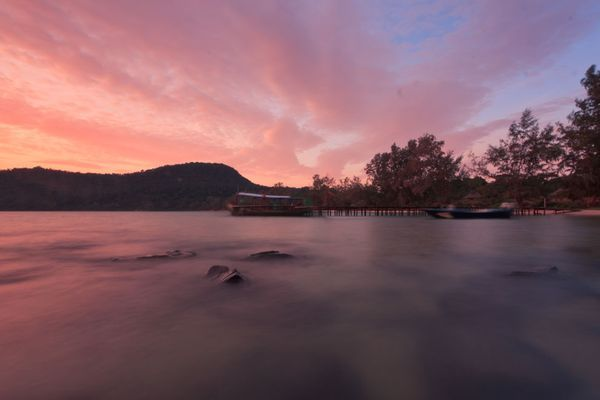 Photo: Pink sunset over the water