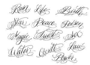 cursive writing tatto