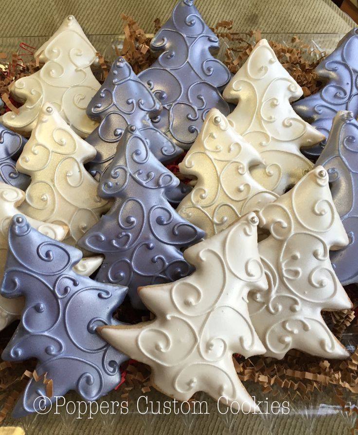 Monochromatic Christmas tree cookies in white and purple shimmer icing. I like the raise detail piped over top.