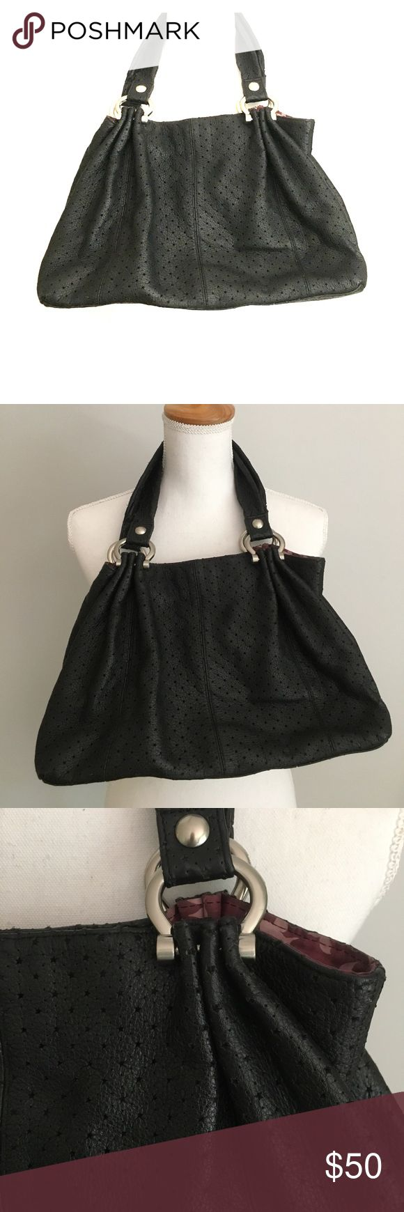 Gap purse Black leather purse. Star cut out detail patterned on bag. Two straps with silver/metal detail. Zipper pocket on interior. Lined. GAP Bags Shoulder Bags
