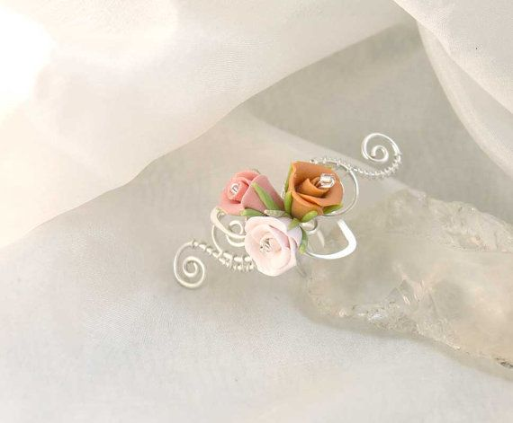 https://www.etsy.com/listing/225655058/tiny-earcuff-with-roses-earcuff-with?ref=listing-shop-header-0