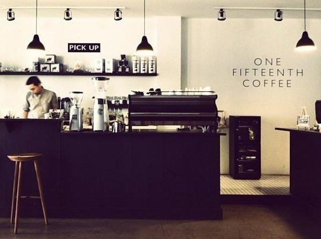 The black, white, and wood theme of One Fifteenth Coffee in Jakarta. | 31 Coffeeshops And Cafés You Wish You Lived In