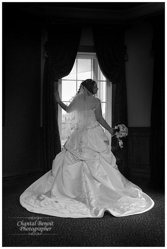 Black and White wedding photo of the bride for her Fall wedding taken indoors