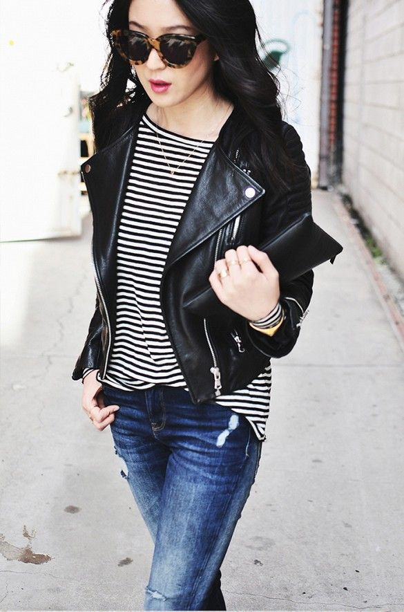 A striped shirt is paired with a leather moto jacket and distressed jeans.: