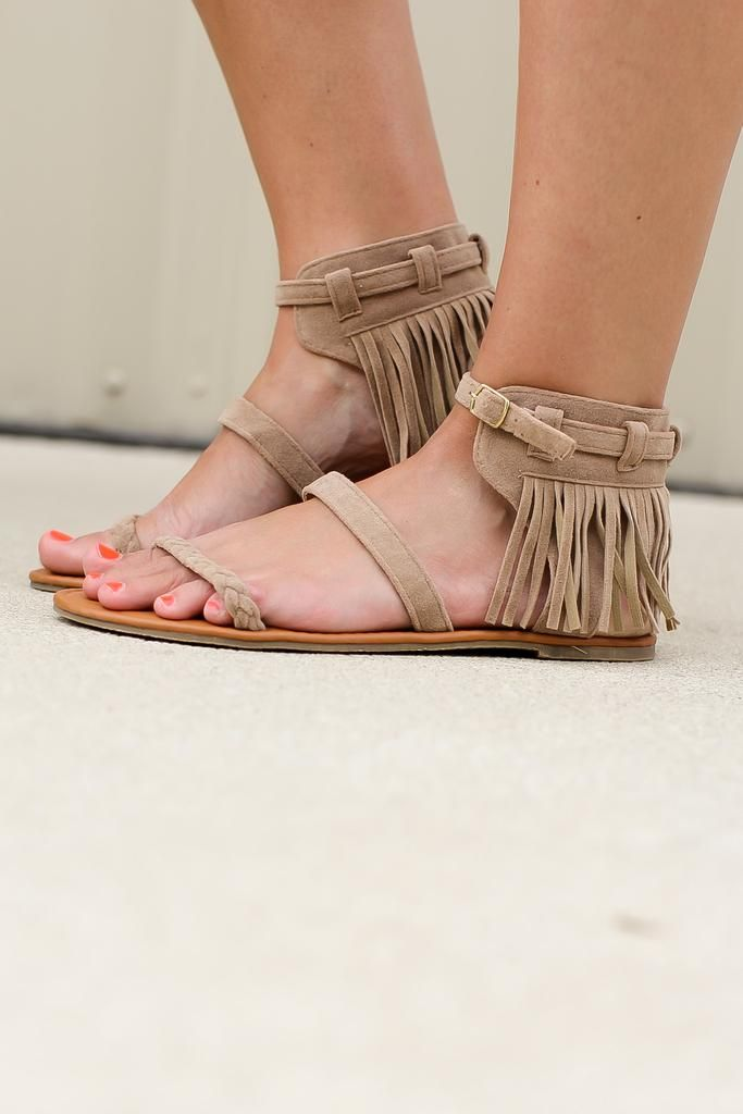 Ankle fringe lends a dash of boho-chic to these strapy sandals.