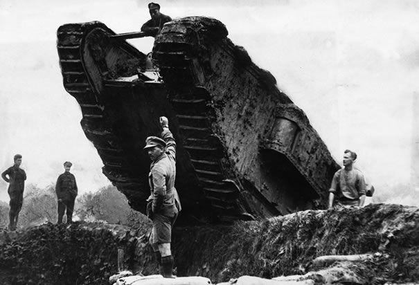 "British Tank Rolling over Trench: Members of the British Royal Navy maneuver a tank, or ""landship,"" over a trench during the 1917 Battle of Cambrai, one of the first successful uses of the tank in World War I."