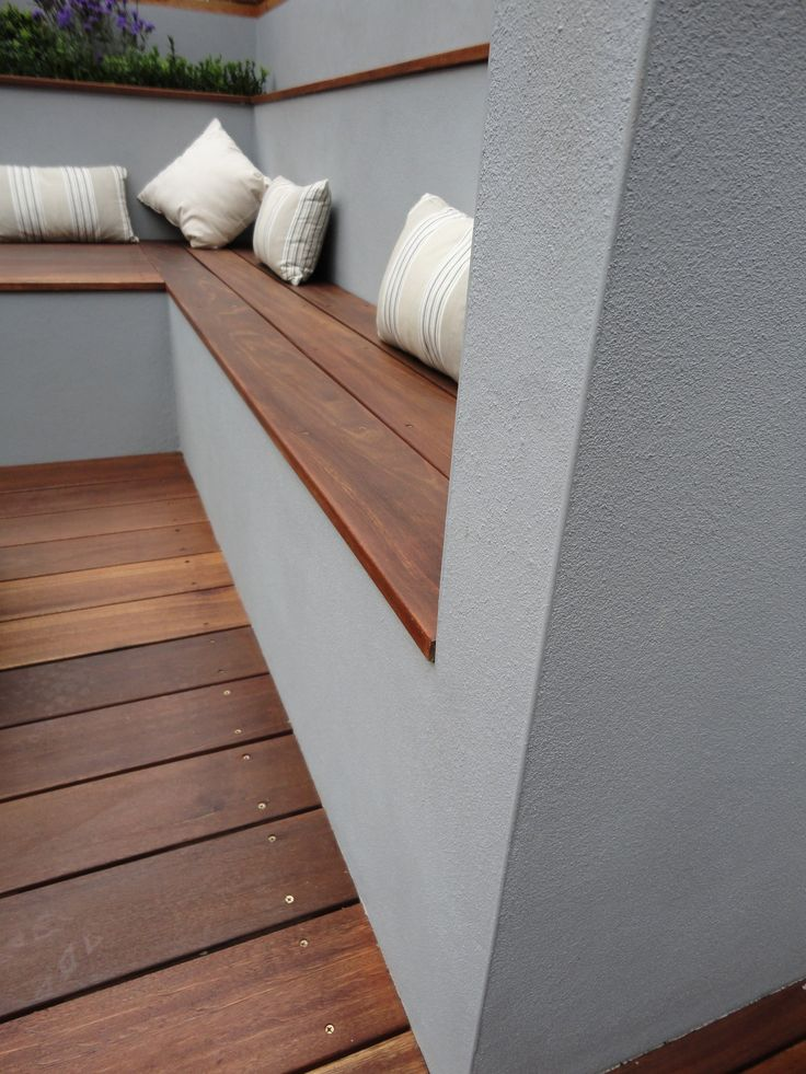 timber coping instead of stone on a rendered garden wall -