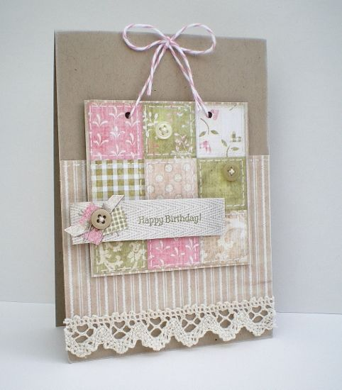 hand made card from Blush Crafts   ...  nine patch quilt  block in soft colors ...  luv the presentation with baker's twine holding it up and a real lace border ...