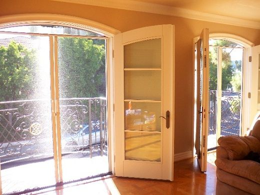 Contemplating replacing the single back door in the kitchen with French doors. With screens!! Wow would these make the kitchen amazing.