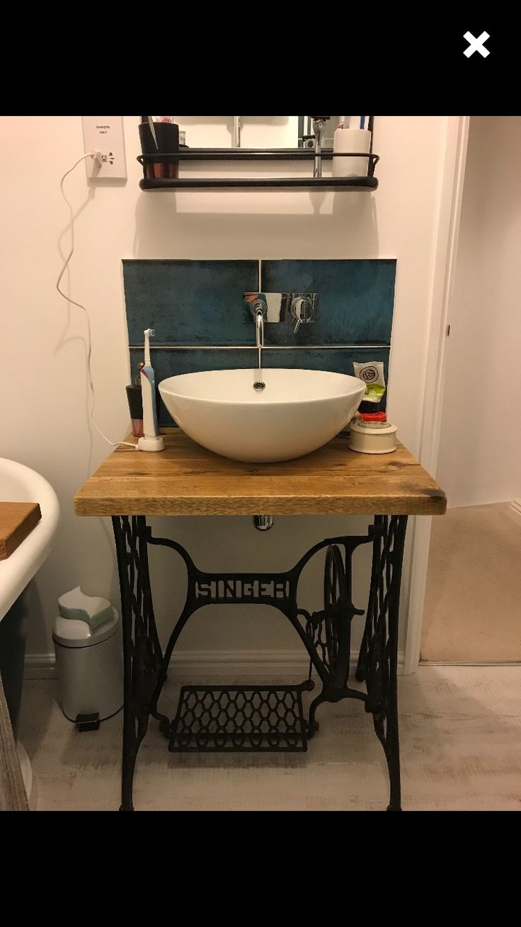 A reclaimed wood unit top I made for this customer, used for a fantastic bathroom unit with an old Singer base. Looks amazing!