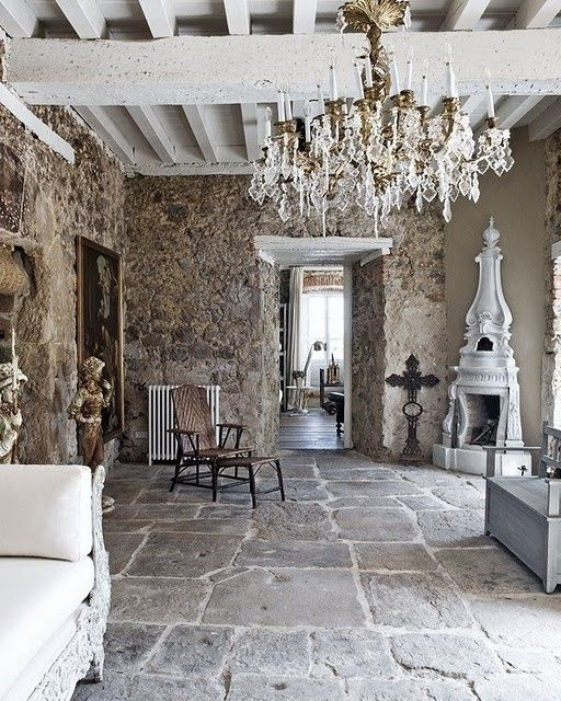 stone walls, exposed beams, stone floor, chandelier, fireplace: