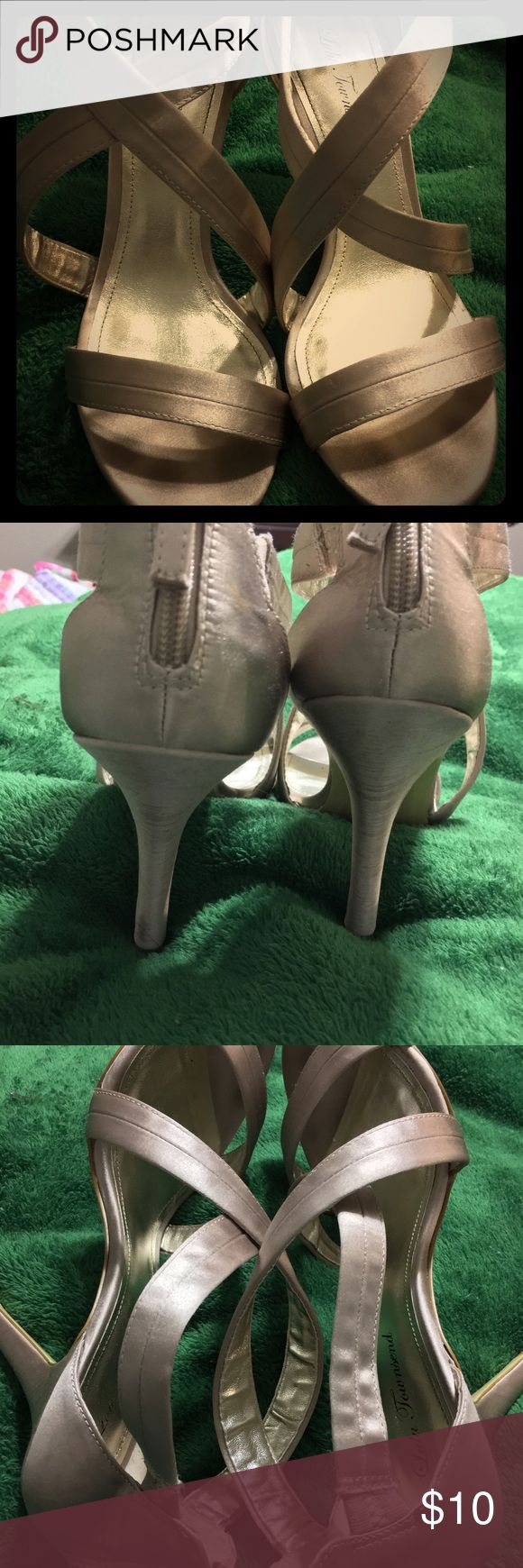 Champagne colored heels size 10 Cute satin dark champagne color shoes. It's a gorgeous neutral. Criss cross design. Worn a few times but in great shape. Zippers up the back. Size 10 Shoes Heels