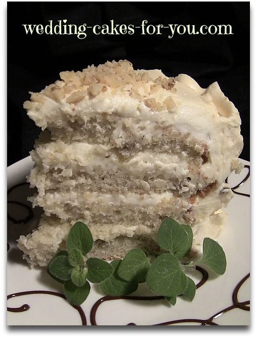 A slice of banana cake. Four layers of moist banana cake with cream cheese filling and a light peanut butter frosting.