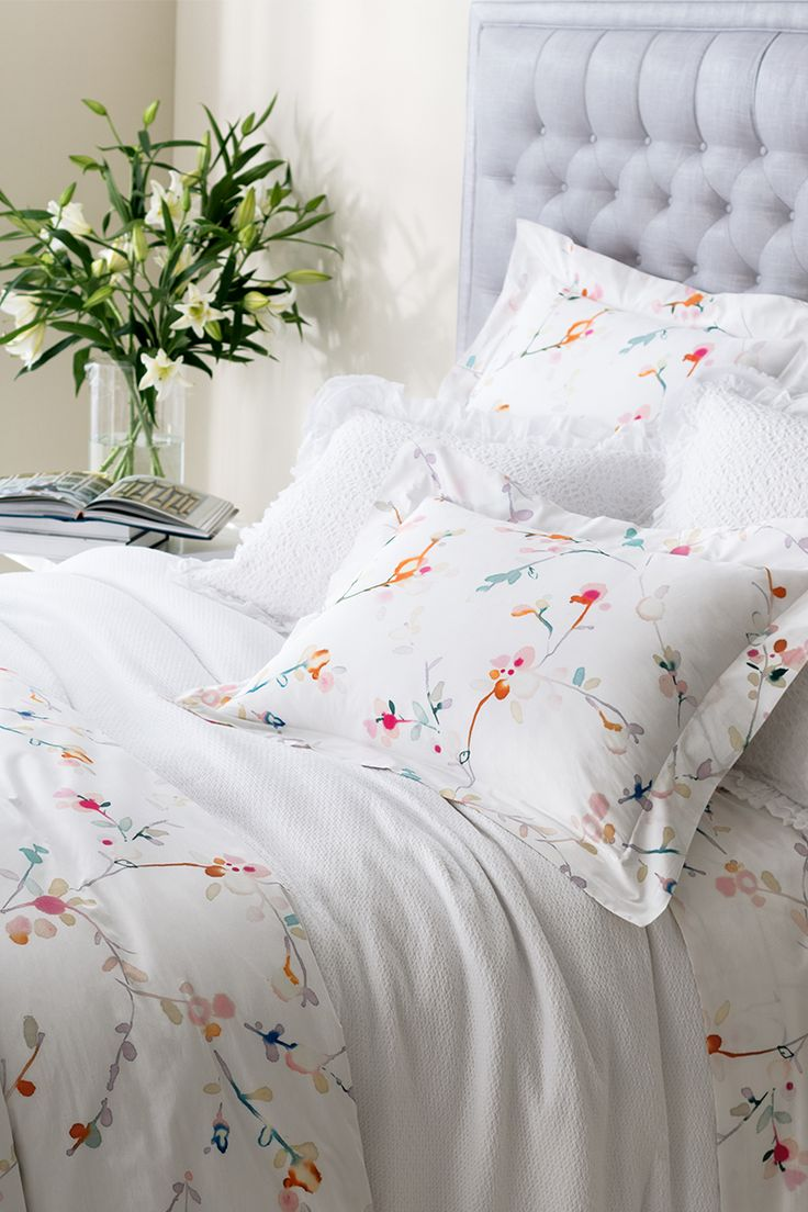 Shop Annie Selke for this pretty, feminine collection, featuring a 400-thread count cotton percale duvet cover and sheets. The blossoms have a lovely watercolor quality that just begs to be partnered with all of our colorful solid bedding. Here we've opted to pair with our Quinn White Blanket and our Matilda shams to create a crisp, clean, restful haven.