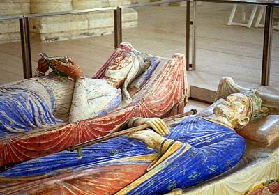 Tombs of Eleanor of Aquitaine and Henry II at Fontevraud Abbey.  Fontevraud Abbey or Fontevrault Abbey is a religious building hosting a cultural centre since 1975, the Centre Culturel de l'Ouest, in the village of Fontevraud-l'Abbaye, near Chinon, in Anjou, France