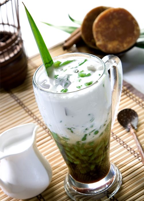 Iced Cendol - a traditional beverage in South East Asia. It's a cold mixture of ice, coconut milk, pandan flavored jelly and palm sugar syrup.