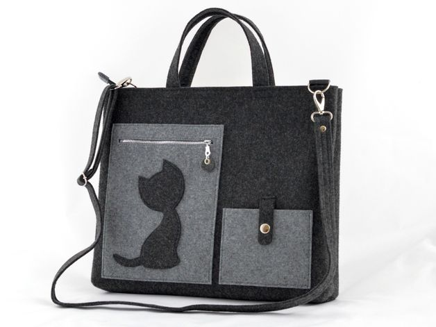 Die Tasche wurde aus dickem, lastbarem Filz gemacht. Interessante  Form mit einer Katze geschmückt.  Filzfarbe- grau/schwarzgrau Sie ist mit Reisverschluß verschlossen. Sie hat eine Vortasche...