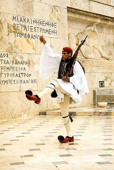Evzone Guards. The dress uniform of the Evezone Guards is based on the uniform of the Greek fighters of the 1821 war of independence and is native to Central and Southern Greece. The distinctive pleated white kilt,  the 'foustanela' is sewn on the bias from many triangular shaped pieces of fabric. It has 400 pleats to represent the 400 years of Ottoman domination.