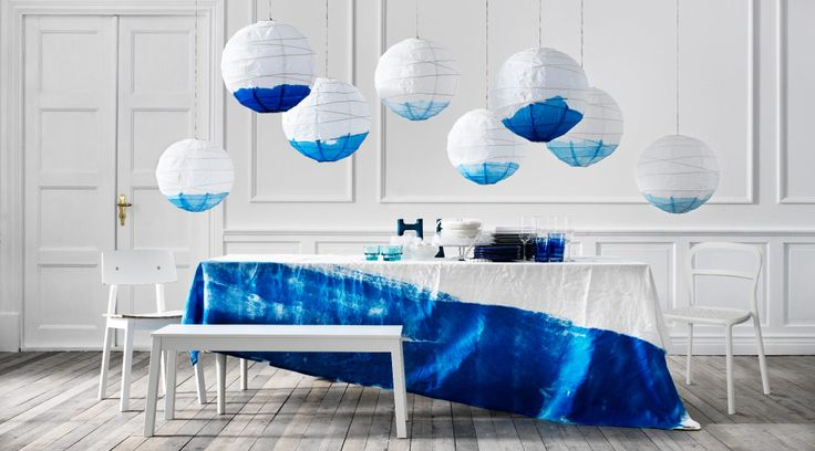 Love this idea for the dining room chandelier. You buy the paper laterns, and dye them the color you want. Then, hang them at different length for that Mid-Century Modern feel. (IKEA)