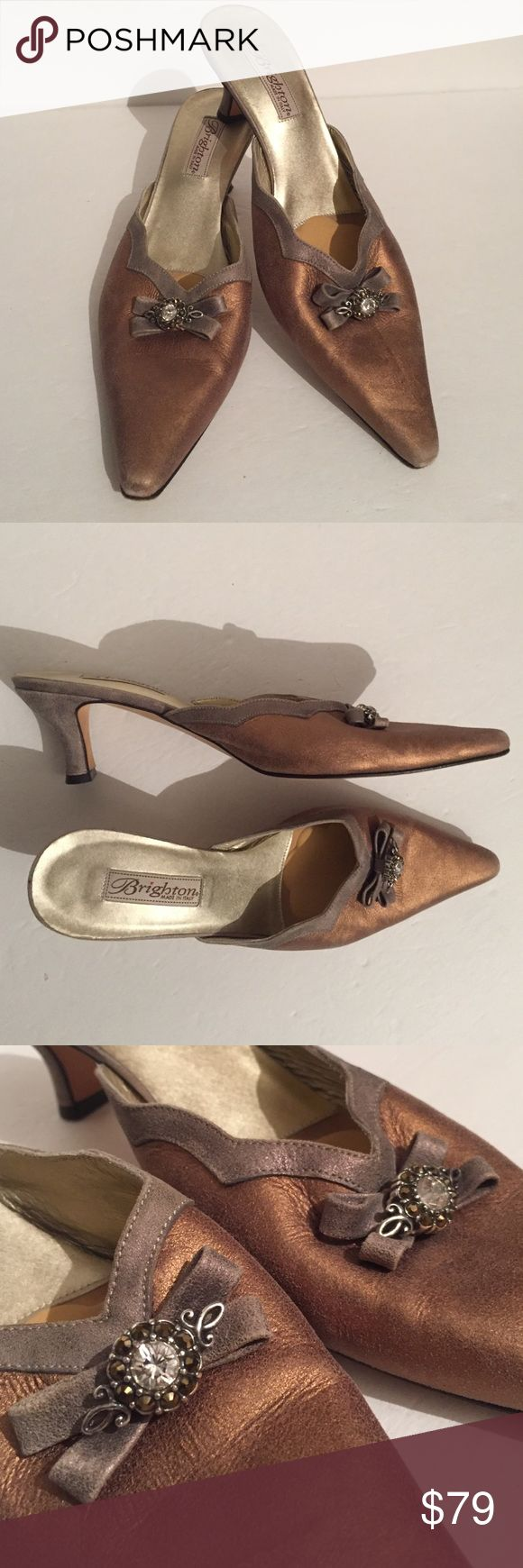 Brighton copper metallic leather mule size 9!! This is a beautiful pair of Brighton copper metallic leather mules size 9. The bow embellishment on the front is absolutely exquisite. Gently used and in very good condition with just the slightest typical signs of wear on the leather around the tip and the heel which is to be expected with fine leather. See photos for details. Brighton Shoes Mules & Clogs