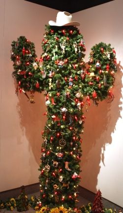 Rachael Gray/Telegram A cactus shape Christmas tree decorated with ornaments and chili pepper lights stands in the corner of Stauth Museum in Montezuma.