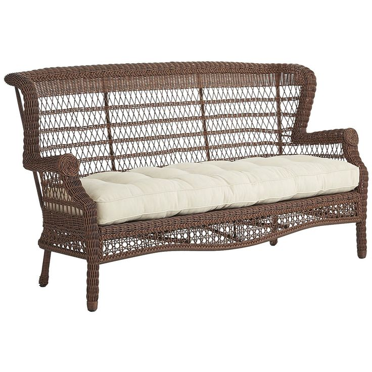 A comfy, traditional outdoor sofa with open-air back, hand-woven construction, fully wrapped legs and rich textures. It's a durable, versatile look for your patio or porch. The finishing touch: One of our soft outdoor cushions (sold separately).