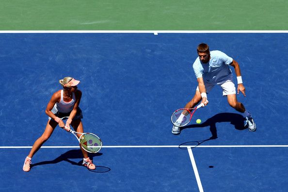 Max Mirnyi of Belarus plays a forehand next to his partner Andrea Hlavackova of Czech Republic during their mixed doubles final match against Abigail Spears of the United States of America and Santiago Gonzalez of Mexico on Day Twelve of the 2013 US Open at USTA Billie Jean King National Tennis Center on September 6, 2013 in the Flushing neighborhood of the Queens borough of New York City.