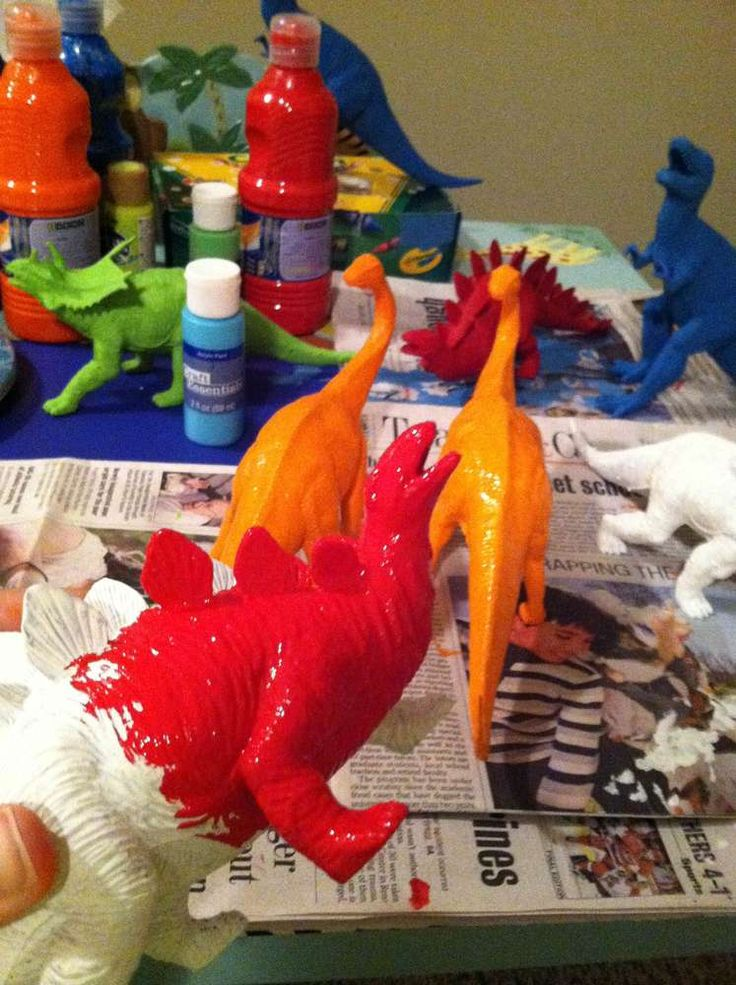 Painting toys at a dinosaur birthday party! See more party ideas at CatchMyParty.com!