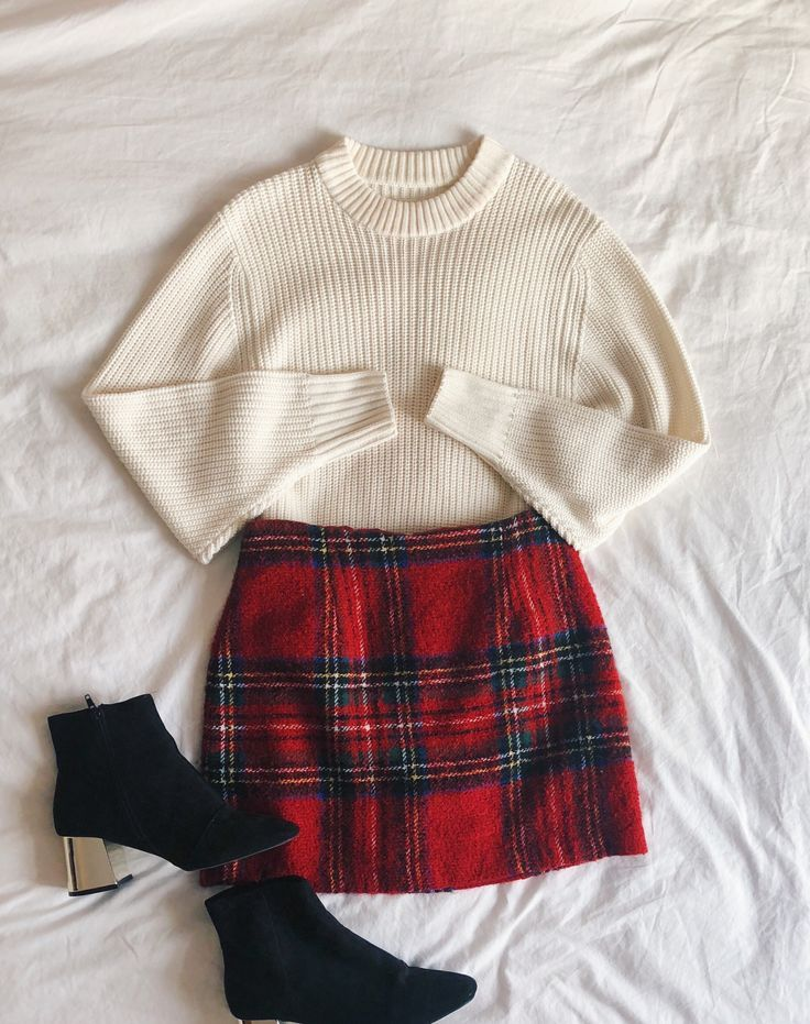 Perfect Holiday Outfit. Cream mock neck sweater with a red plaid skirt and black…