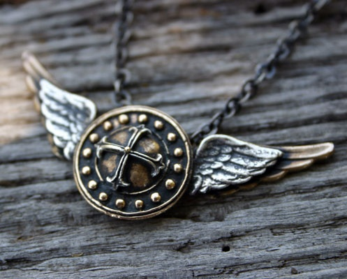 Fabian y Felipe Jewelry.   St Michael shield and wings  pendant and necklace.   I want these bad!