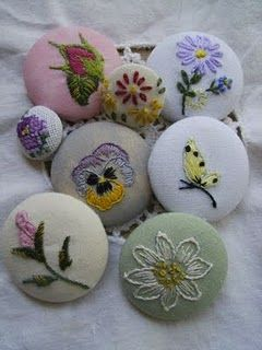 Embroideried covered button. Have bits of old pieces, these would make cute pins for jackets, too!