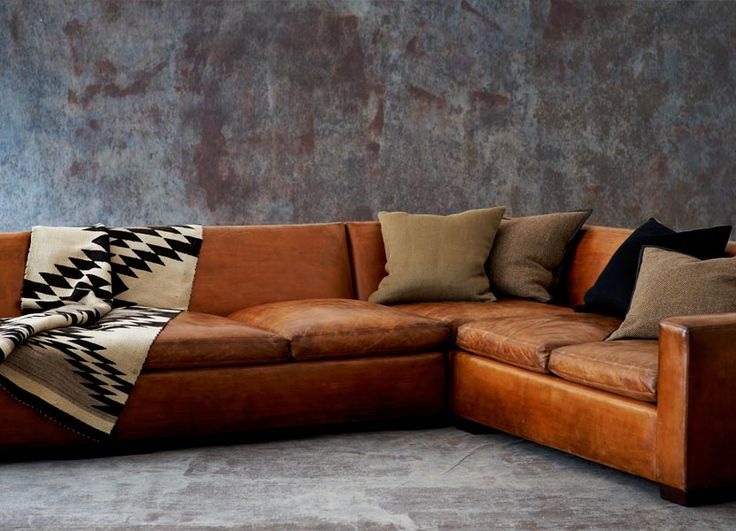 leather sofa styled with brown and black pillows (RL home)