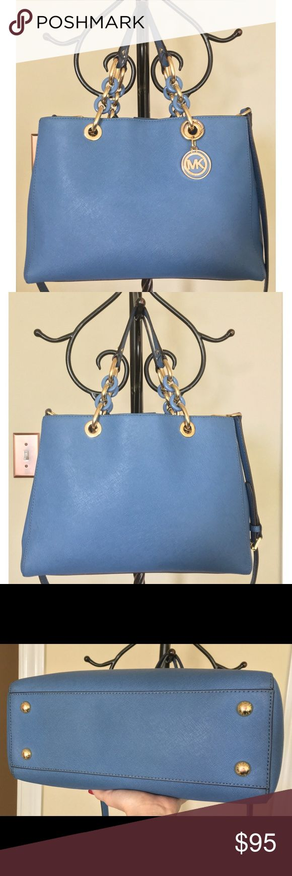"""Michael Kors Blue Saffiano Leather Satchel 💙 Gorgeous Michael Kors Blue Saffiano Leather Satchel in EXCELLENT CONDITION 💋. This beautiful bag will elevate your wardrobe and always make you feel beautiful ❤️! Interior features large central zip compartment as well as 4 organizer pockets and 1 zip pocket. Handles drop measures 6.5""""; shoulder strap drop measures 20.5"""". Has a few very minuscule marks on exterior (hardly noticeable) and slight wear on strap (pictured). Nonetheless excellent…"""