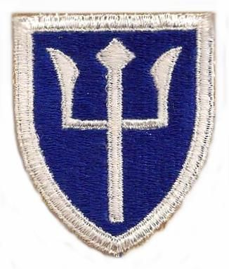 Nickname:   None recorded. .  Shoulder Patch: A vertical white trident on a blue shield with a white border. The patch was designed in 1922, when it was contemplated the 87th would be manned by personnel from Maine, Vermont and New Hampshire. .  History:  The 97th Division was first organized at Camp Cody, New Mexico, September, 1918. It