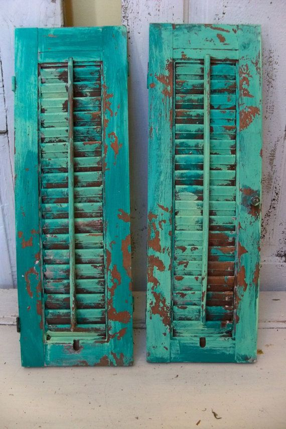 Calypso blue distressed shutter wooden hand painted very distressed home decor Anita Spero     This one slides apart if you want it to. You can use it to flank wall art etc;   Our keep it as one piece.  This hand painted shutter has so many uses, and adds great texture to your wall or table. Its perfect as is for a wall decor piece. You can add this to your vanity or dresser to showcase favorite jewelry pieces. Great as a photo prop or back drop for Etsy sellers. Put this near your indoor…