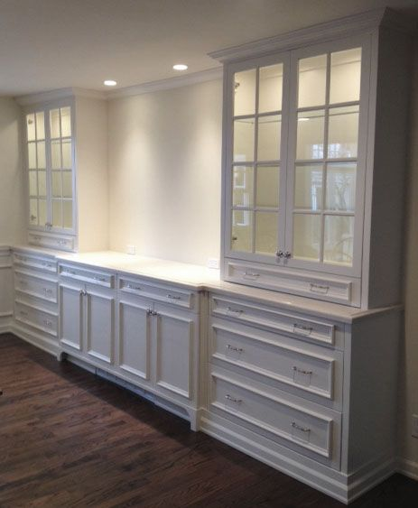 Marianne Simon Design/This design is perfect for what I want in the laundry room....just add open shelving in the center instead of space for the TV.