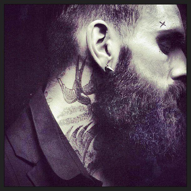Neck tats and beards.