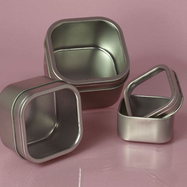 Windowed Square Tin Cans - Could be used for magnetic spice rack but it is not coated with plastic on the inside nor is it rust proof. If that doesn't matter, these can be purchased for about $0.90/ea. when purchased in a pack of 24 in the 4 oz. size.