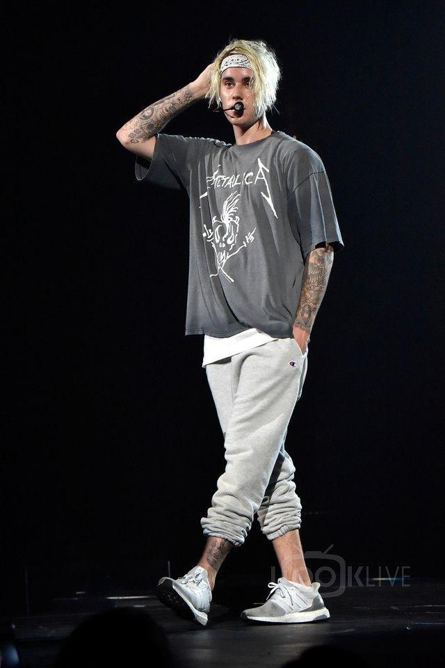 Justin Bieber wearing  Adidas Ultra Boost Sneakers, Champion x Justin Bieber Purposetour Sweatpants, Fan Merchandise Metallica No Where Else To Roam T-Shirt