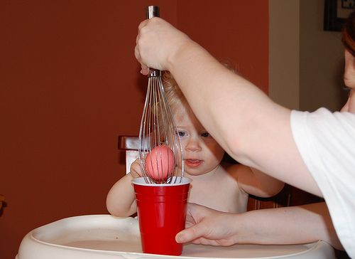 Use whisks to hold eggs for dying,  I will have to remember this for Easter!  Genius.