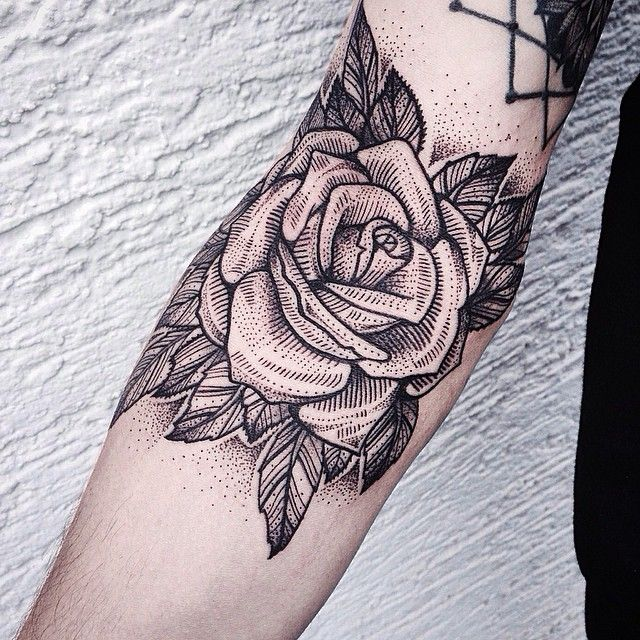 Awesome dot and linework. Makes it a little more unique than the average rose tattoo.
