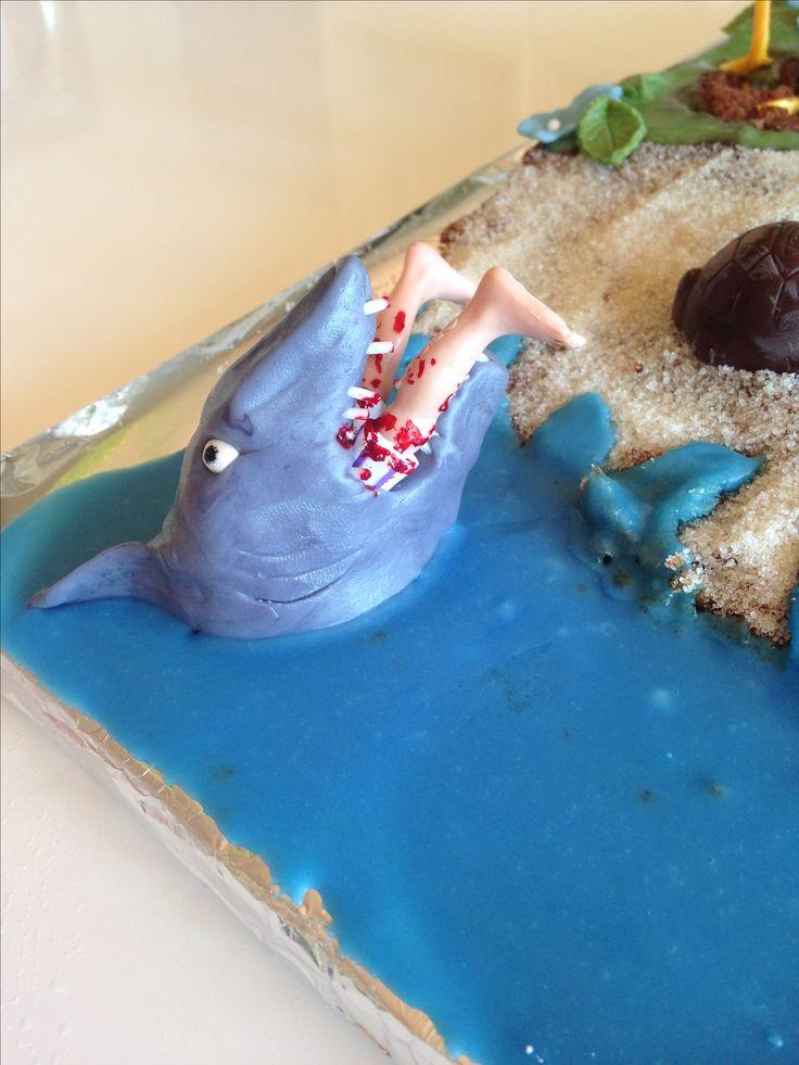 Shark eats man cake.