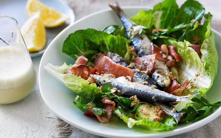 This Caesar salad recipe from My Kitchen Rules' Scott Gooding's book, Clean Living, includes grilled sardines, crisp bacon and brussels sprouts for a healthier, Paleo version of the classic salad.