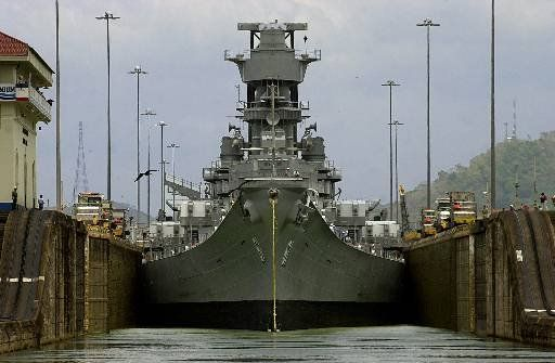 The USS Iowa crosses the Panama Canal at Miraflores Lock near Panama City, Panama Wednesday, March 28, 2001. At 108.2 feet wide, the Iowa-class battleships are the largest vessels ever to scrape their way through the 110-foot-wide locks of the canal. They were designed so that they could just fit through the waterway. (AP Photo/Tomas Munita)Military Ships, Panama Canal, Panama Cities, Navy Ships, Cold Wars, Iowa Bb61, Boats Ships, Battleship Iowa, Uss Iowa