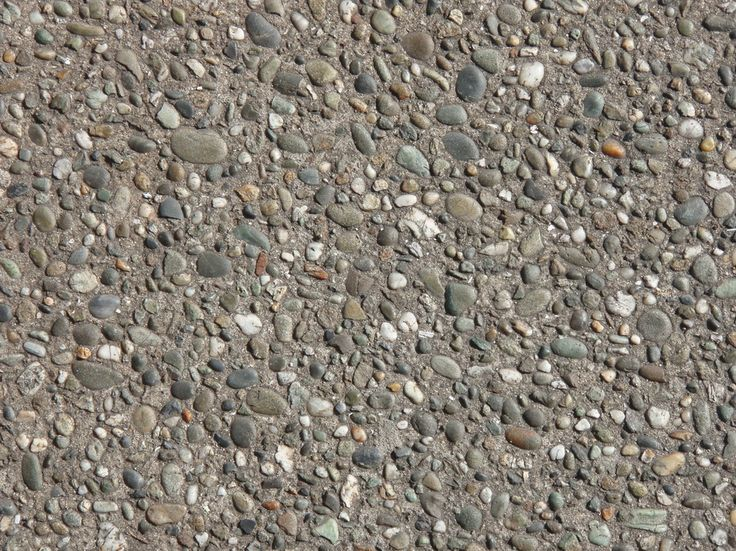 closeup of stone chip seal driveway, cheaper and more durable than asphalt