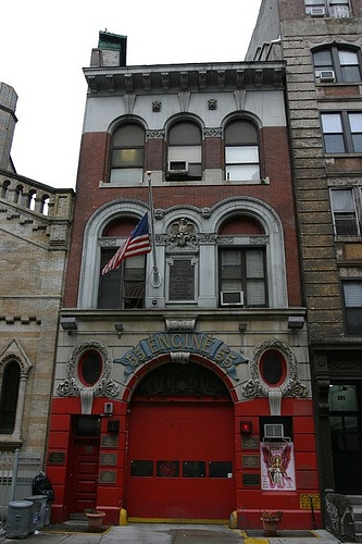 FDNY Engine 55, Little Italy, New York City, USA    Fire Department of New York's Engine Co. 55 in Little Italy. The plaques on the fire hall commemorate firefighters from this company that gave their lives in the line of duty, including five from 9/11.    © Eric Lafforgue