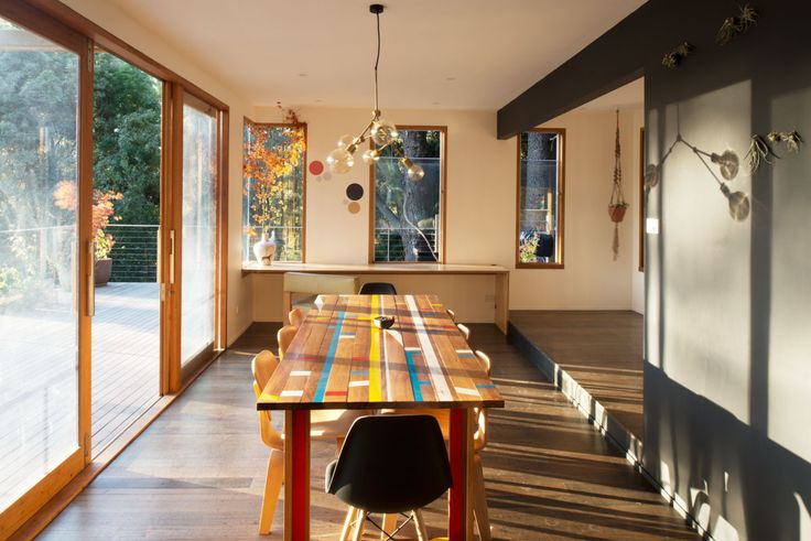 Expanded dining & sitting area with new sliding doors and sashless windows to an expanded decked area at the Kallista Project in association with Deb Kunda Architect