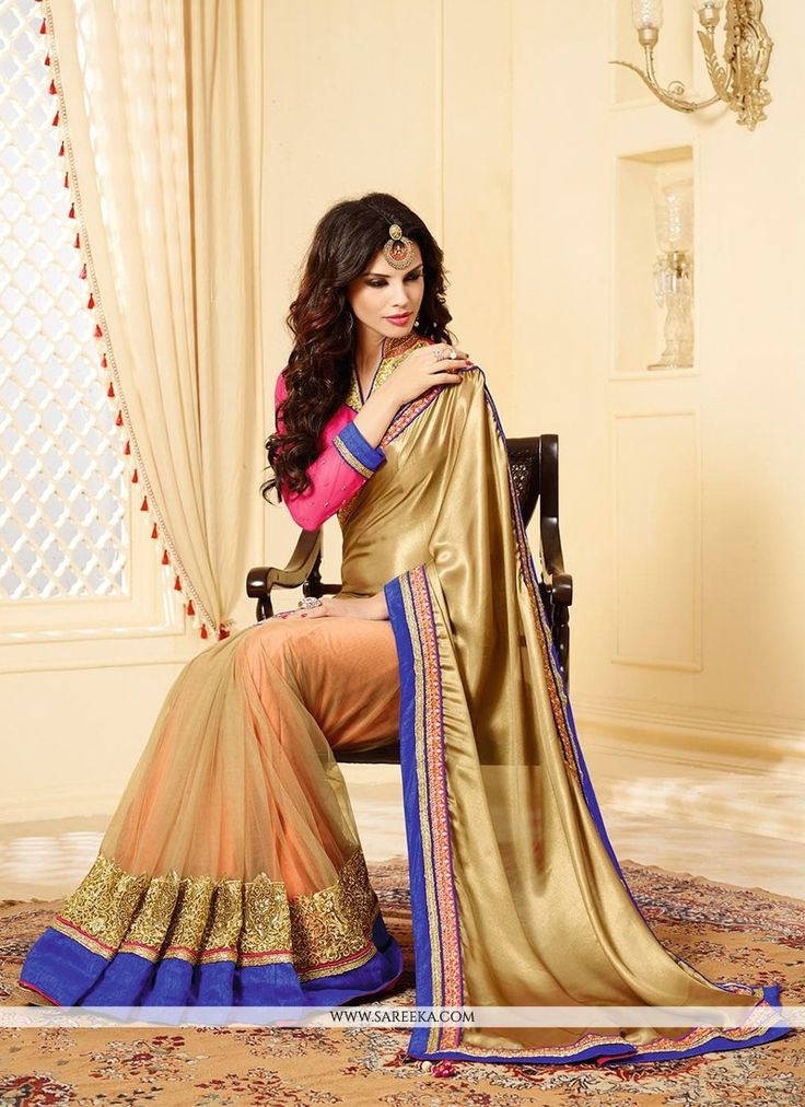 Beige and cream satin georgette designer saree designed with embroidery, zari, lace, resham and patch border work. Available with net blouse fabric, blouse shown in the image is just for photography p...